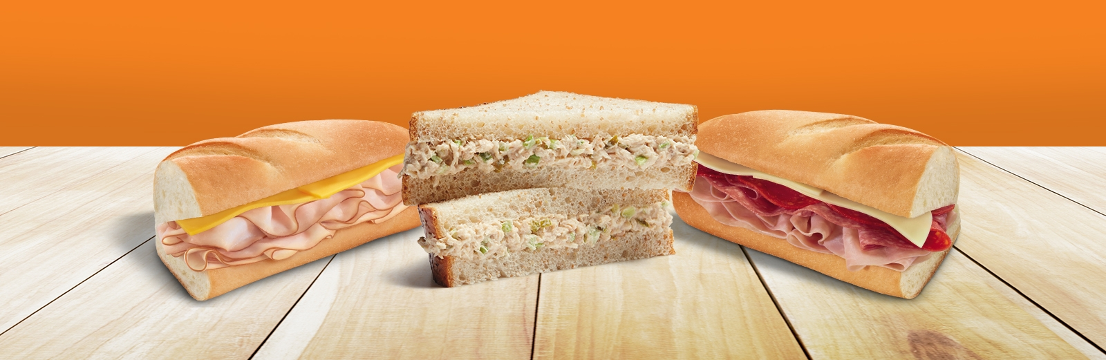 7-Eleven sandwiches featuring a turkey and cheese sub sandwich, an italian sub sandwich, and a tuna salad sandwich.