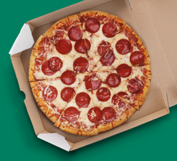 A top down view of a fresh baked pepperoni pizza on a green backgound.