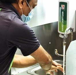 v3-Inside-a-7-Eleven-store-employee-washing-hands.jpg