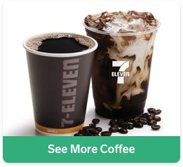 2 cups of 7-Eleven take out coffee with scattered coffee beans on a white background, with a white background
