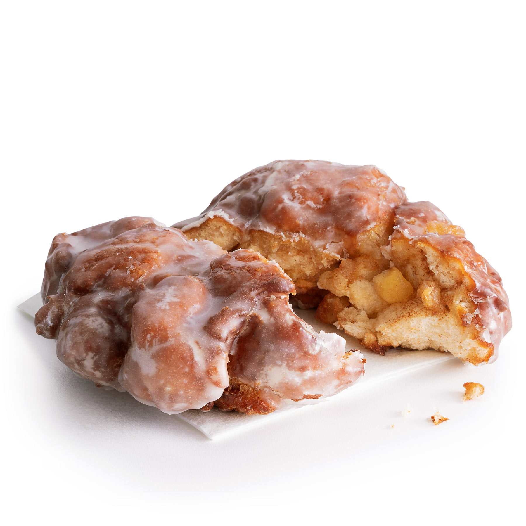 A freshly made Apple Fritter from 7-Eleven, filled with apples, cinnamon and drizzled with a sweet glaze.