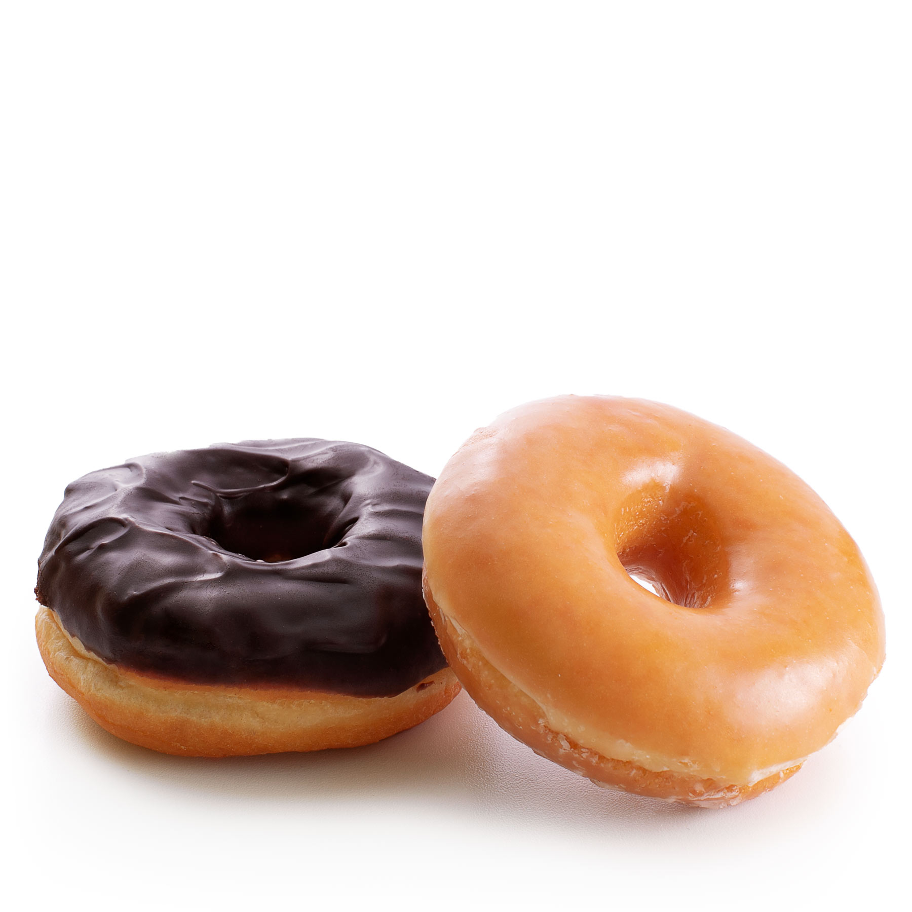 Freshly baked donuts, one chocolate glazed donut and a plain glazed donut.