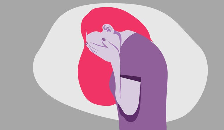Illustration of a woman who is covering her head with her hands due to an anxiety attack.