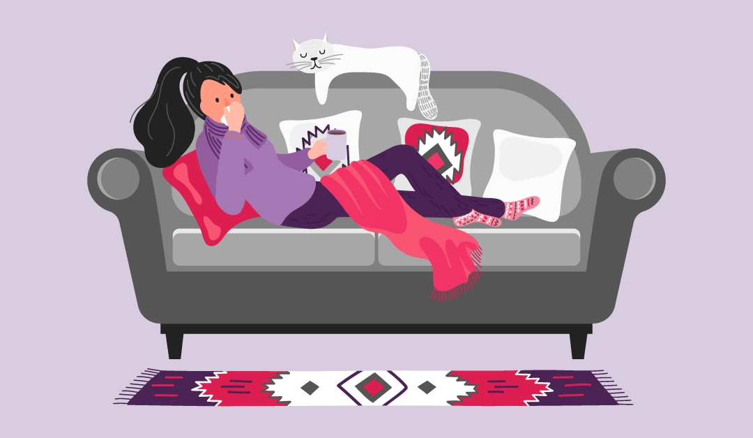 Illustration of a woman laying on her couch with her cat and is blowing her nose while battling the cold and flu