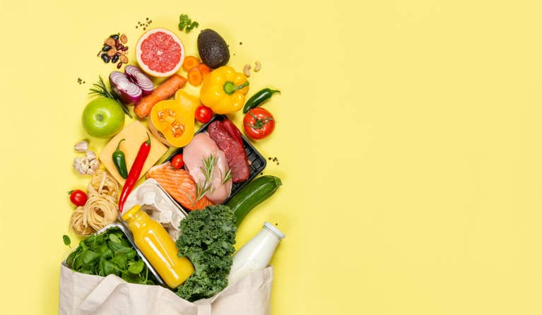 Sack of vegetables sprawled along a yellow background to help with good renal diet
