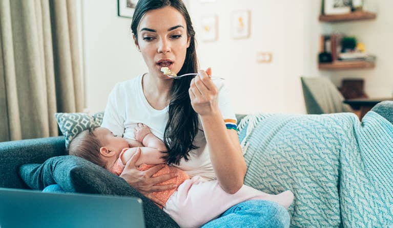 Women breastfeeding while eating lunch.