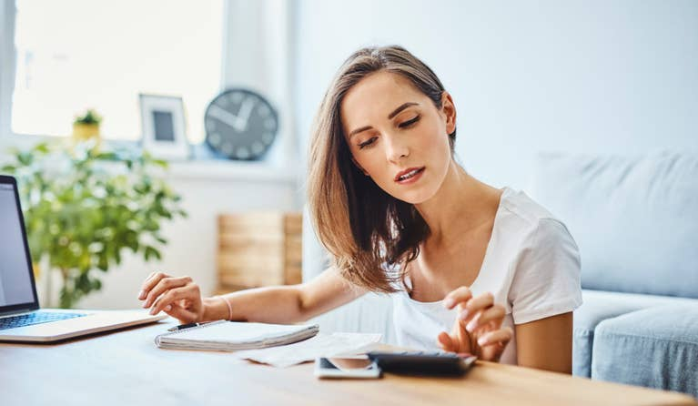 Woman at desk trying to figure out if she has the right health savings account