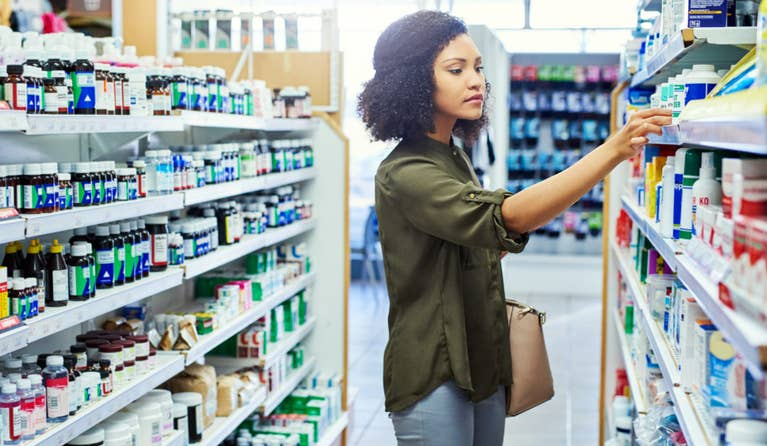Woman looking for her prescription at her nearest national pharmacy
