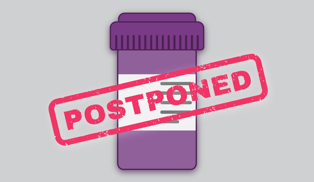 "An illustration of a pill bottle with ""postponed"" in front of the bottle"