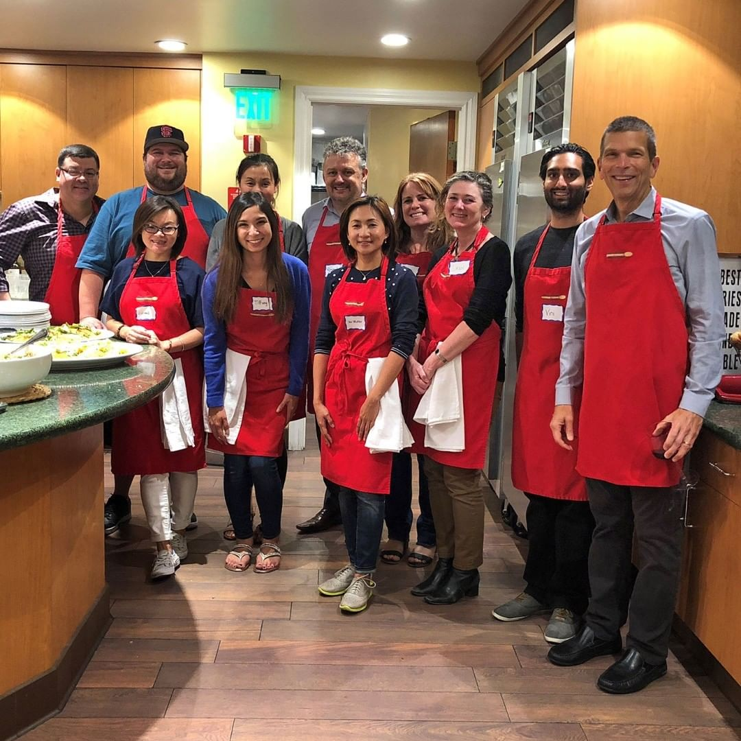 Our awesome employees hanging out!Take the finance team, put them in a cooking class, add some red aprons and stir up some fun. What do you get? A tasty teambuilding activity! #YapStone #cookingclass #teambuilding