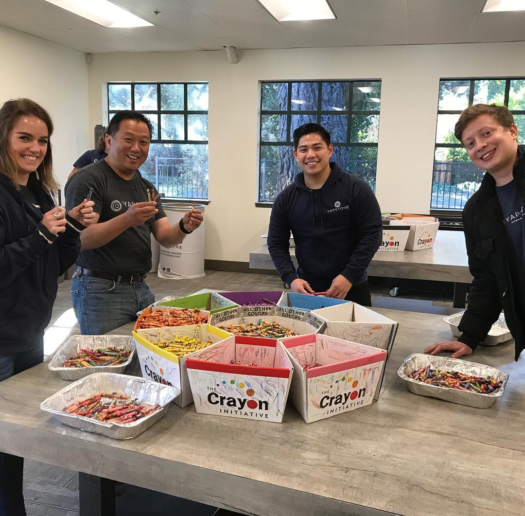 At #Yapstone, we love giving back. A few of our marketing #Yapsters used their #Yapcares volunteer day to help out at @thecrayoninitiative to make old crayons into new ones for hospitalized children. #makingadifference #teamwork #crafty