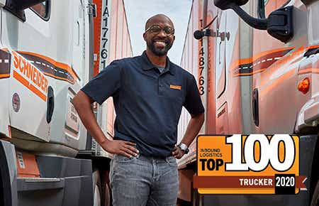 Schneider driver poses with trucks and trailers