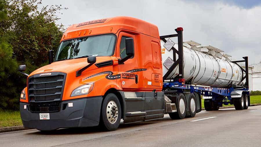 A Schneider tractor hauls a bulk intermodal express container.