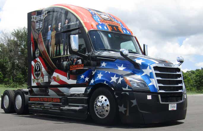 Schneider's new Ride of Pride truck is decorated with bold decals featuring patriotic and military images