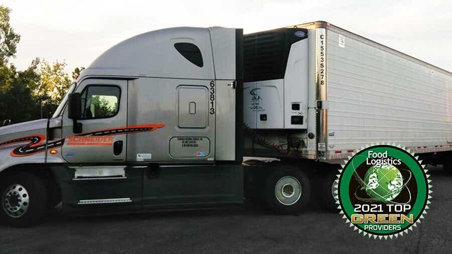 Schneider tractor and trailer parked.