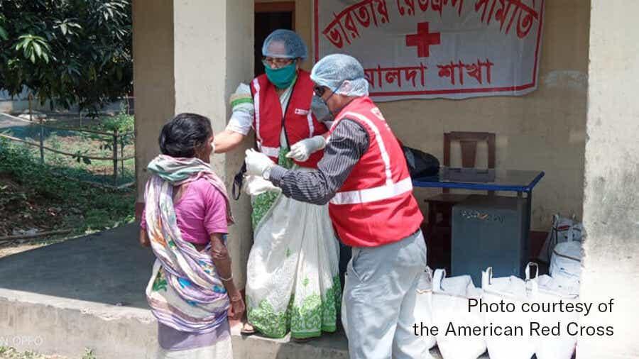 Volunteers work COVID-19 relief in India.