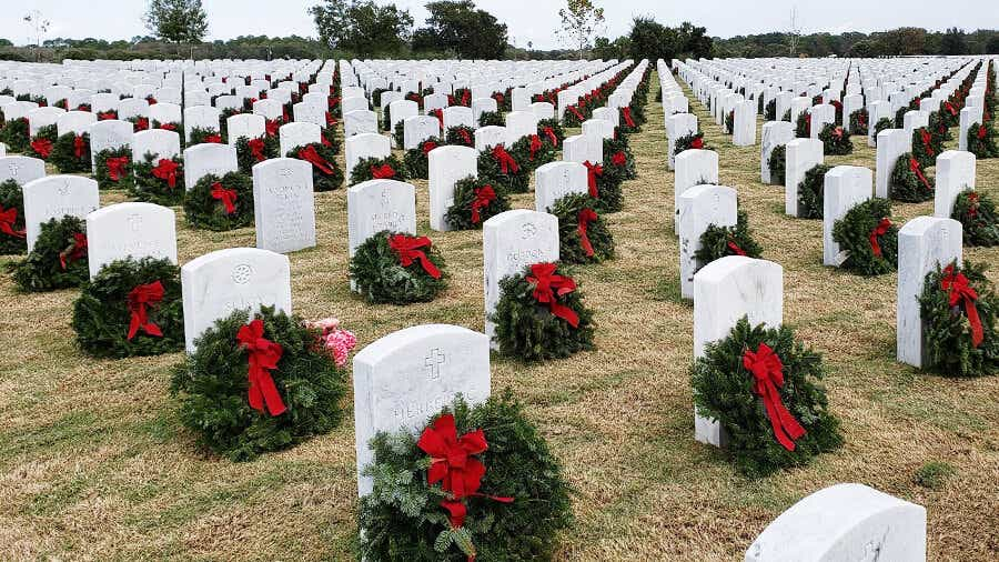 Wreaths adorning the graves of fallen military veterans