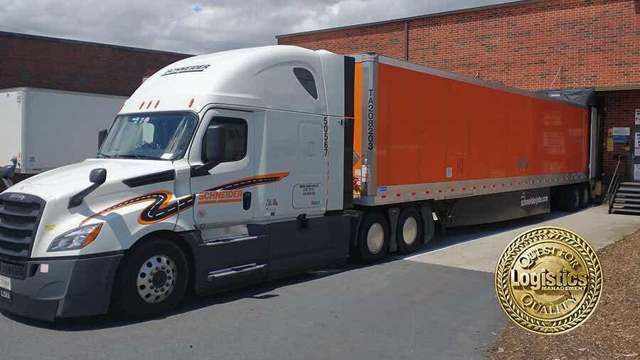 Schneider truck parked at loading dock.
