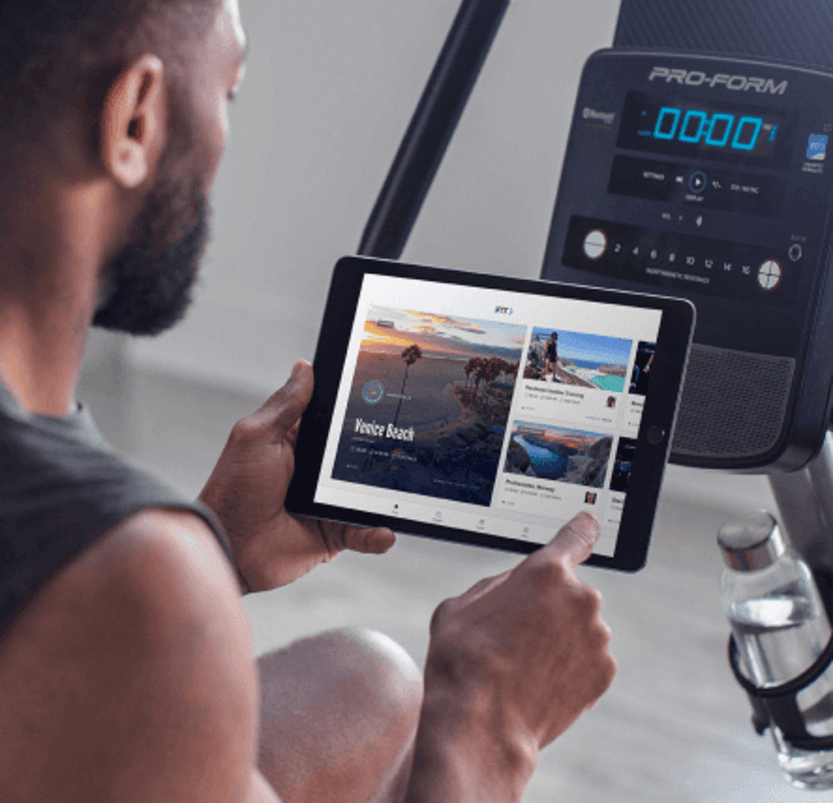 Man does an iFIT cycling workout on his bike