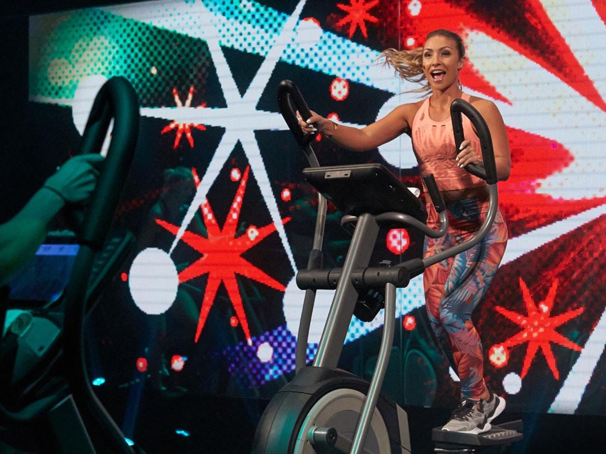 Trainer leading elliptical class
