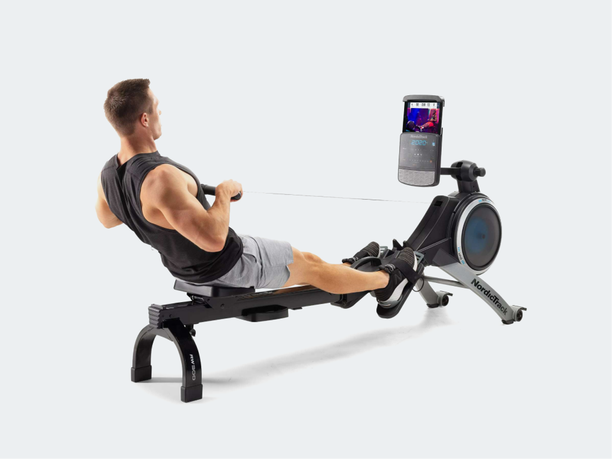 Man working out on iFIT rowing machine.