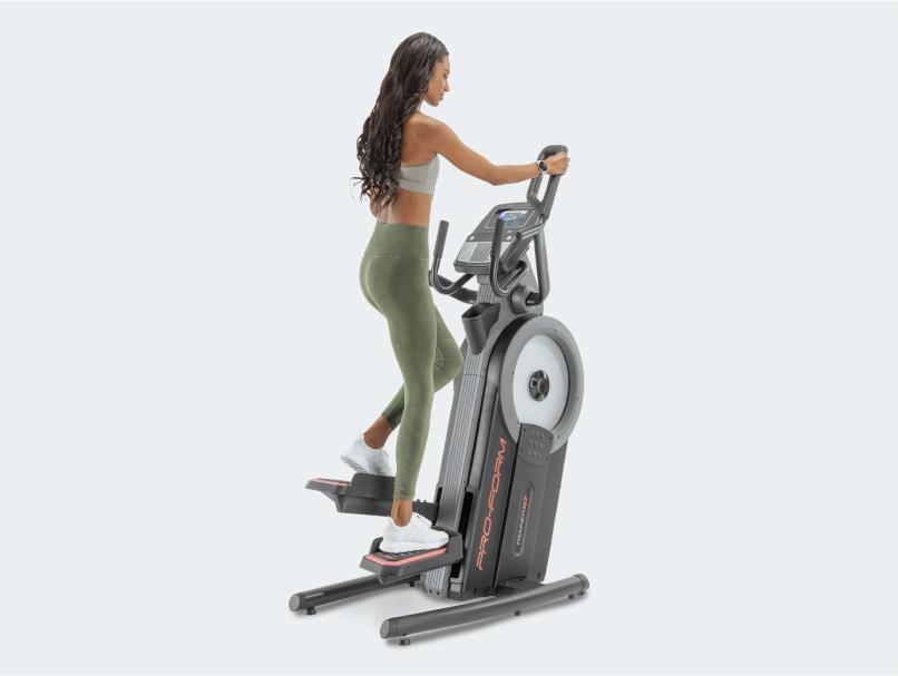 Woman uses ProForm elliptical machine