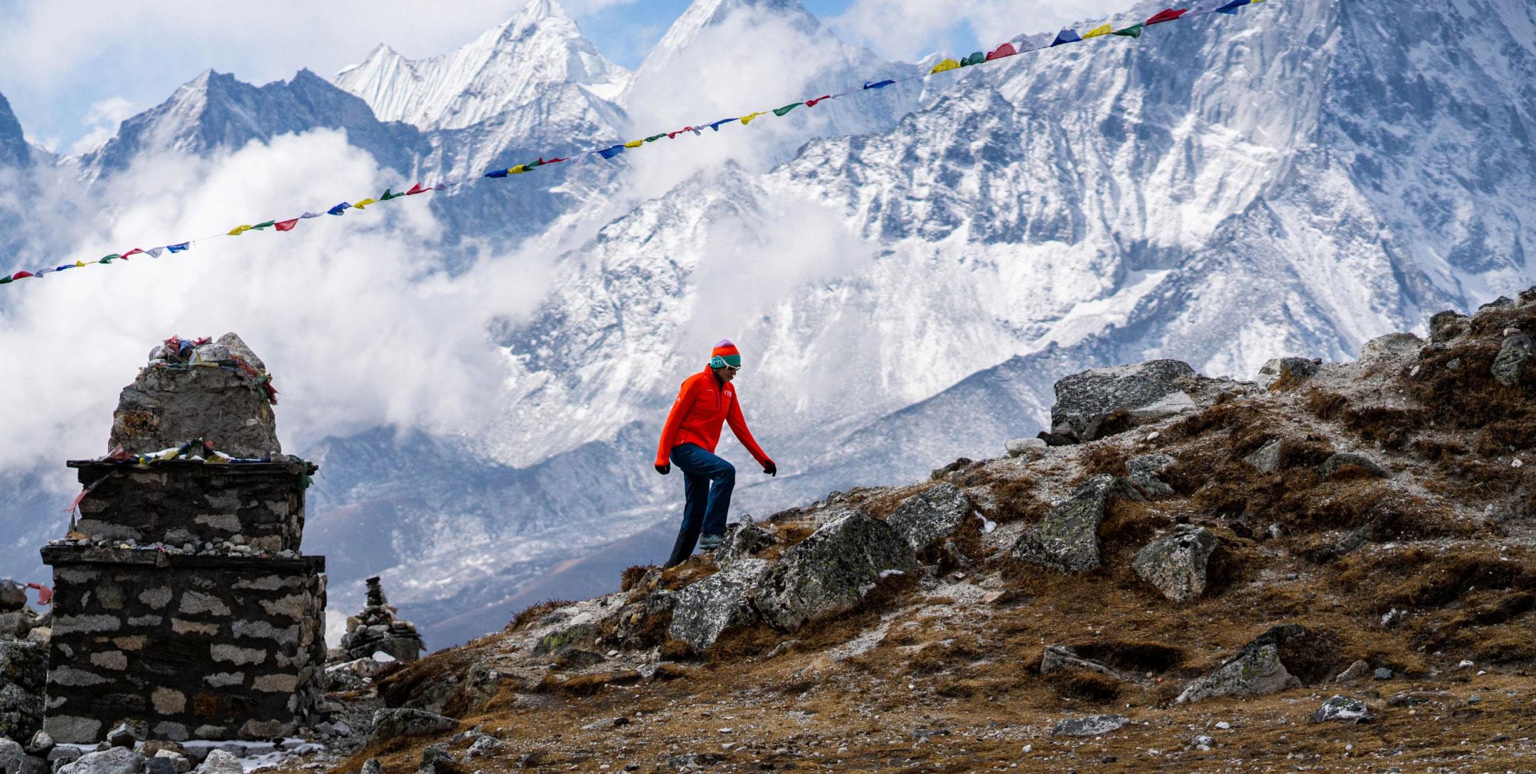 Climber treks up a beautiful mountainous path