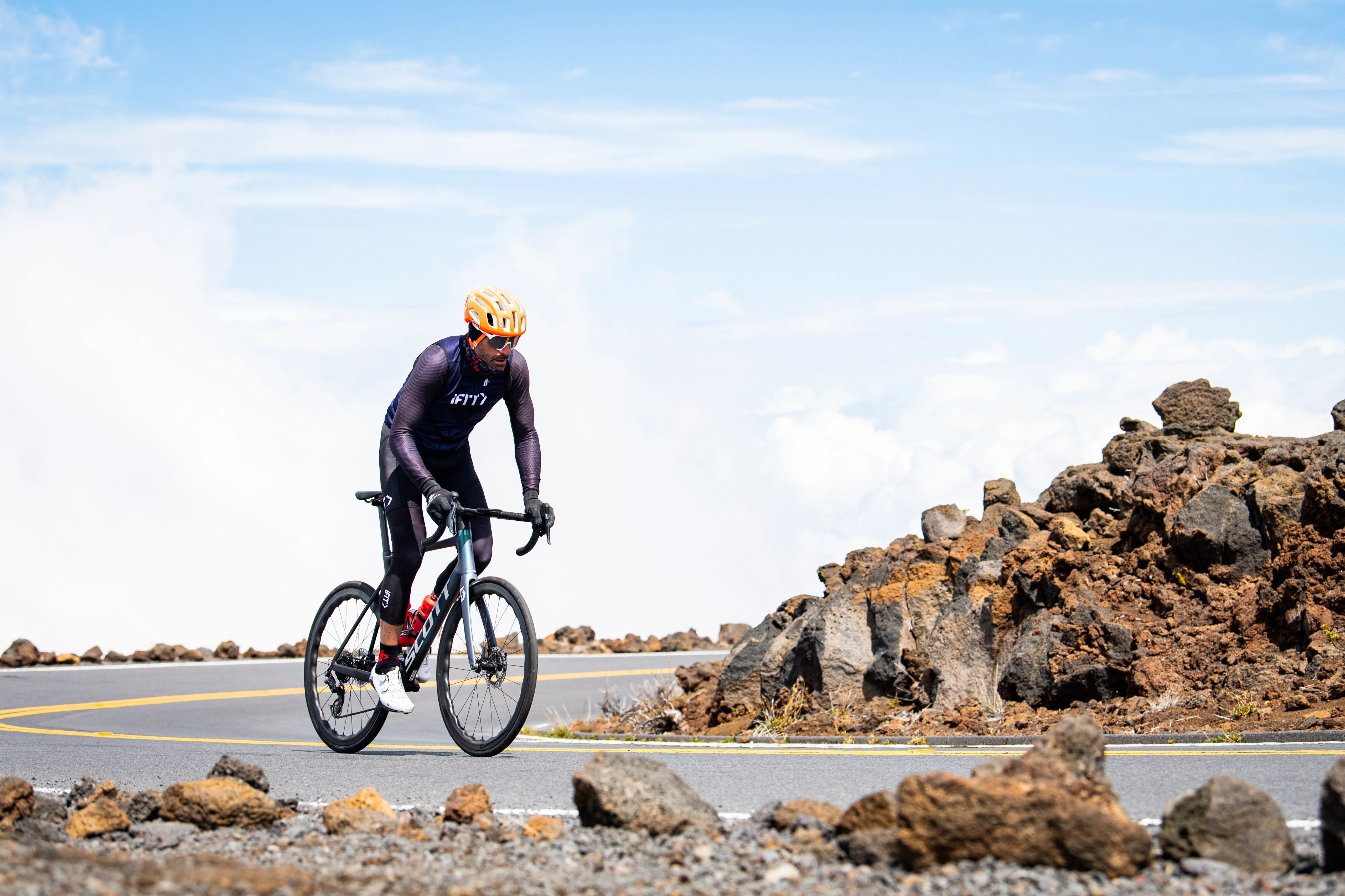 Man riding a bicycle a road bike outside