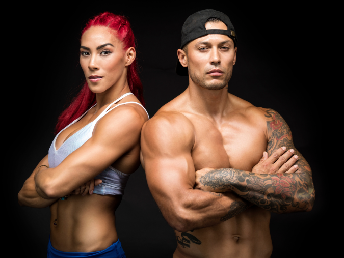 Two iFIT trainers with arms crossed