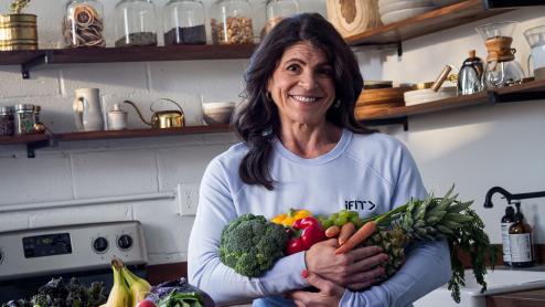 Dr. Eva Selhub holding vegetables