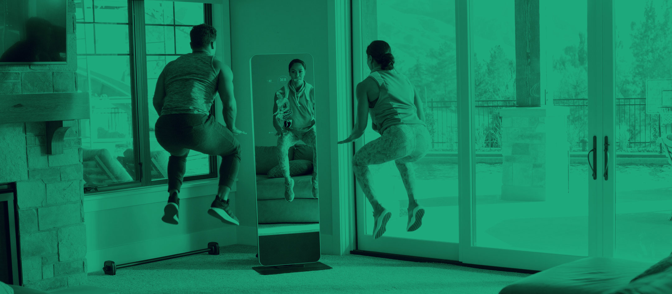 Man and woman exercising in-front of a fitness mirror