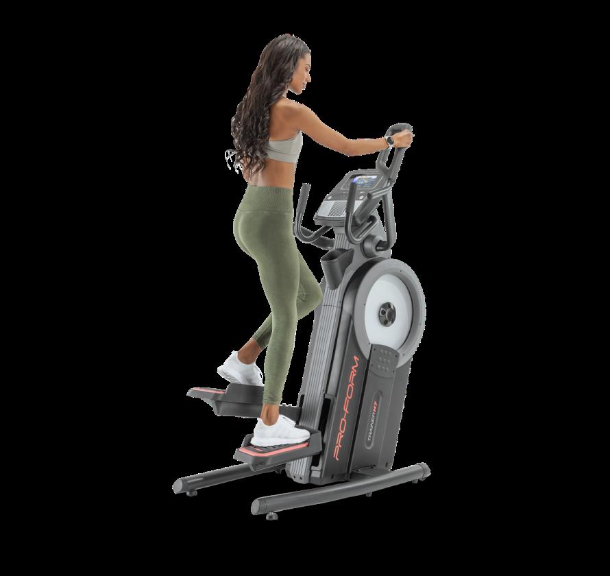 Woman using elliptical machine