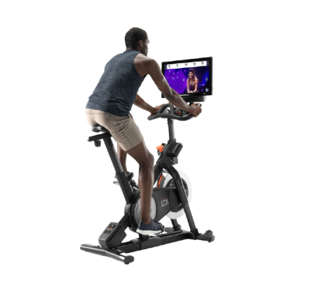 Man does a cycling workout on an iFIT-enabled bike