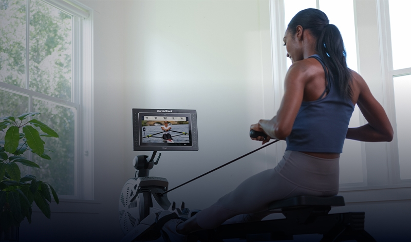 Woman using NordicTrack rower for iFIT class