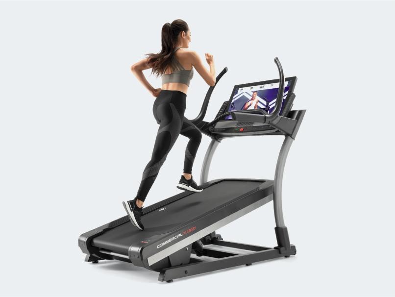Woman runs on incline treadmill