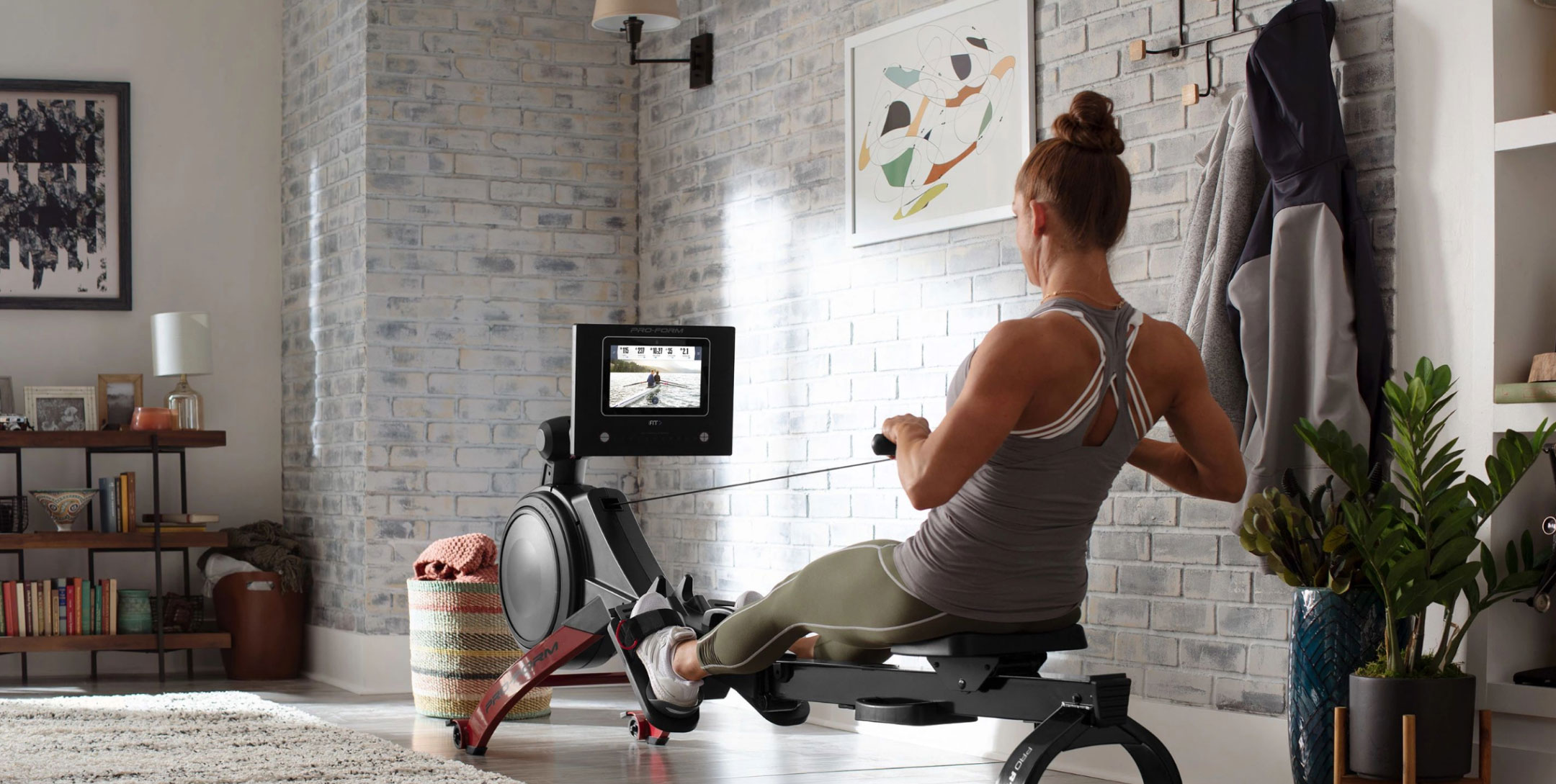Woman uses rower at home