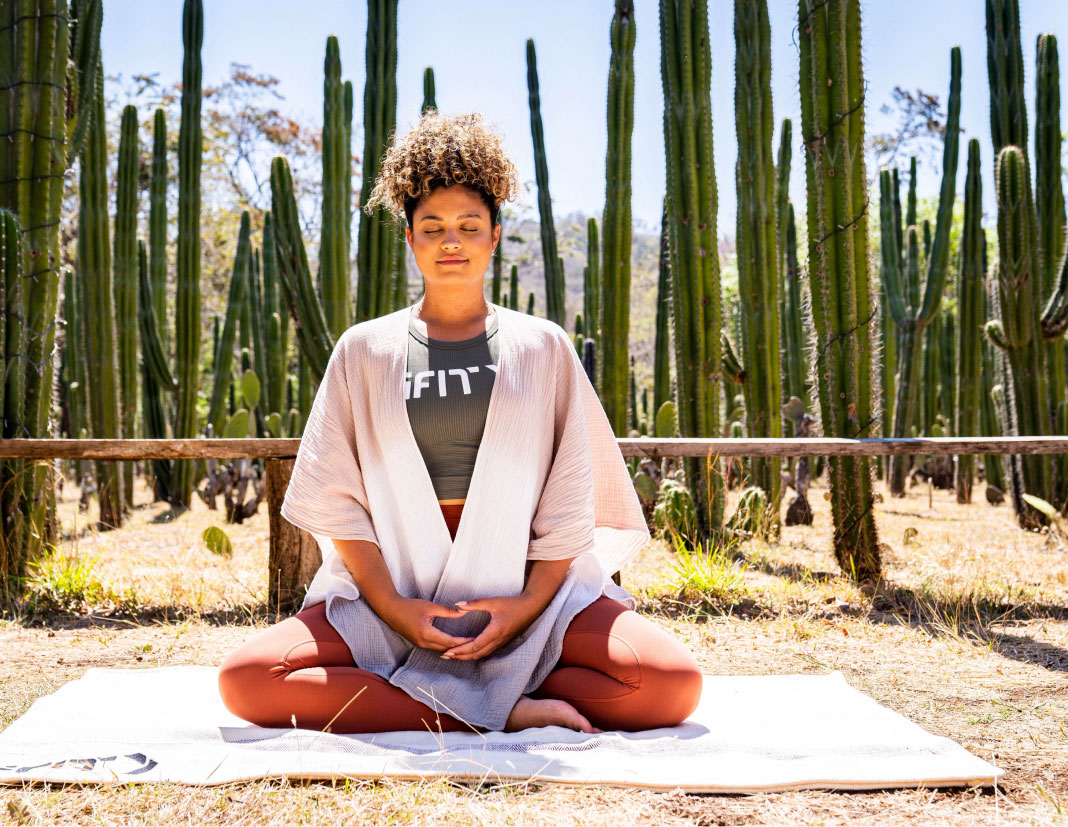 Woman does an iFIT meditation class