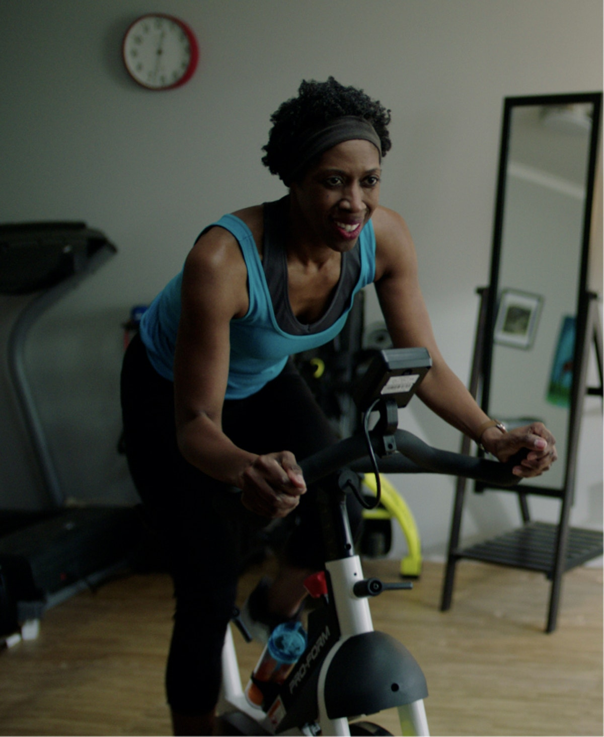 iFIT member works out with a bike class