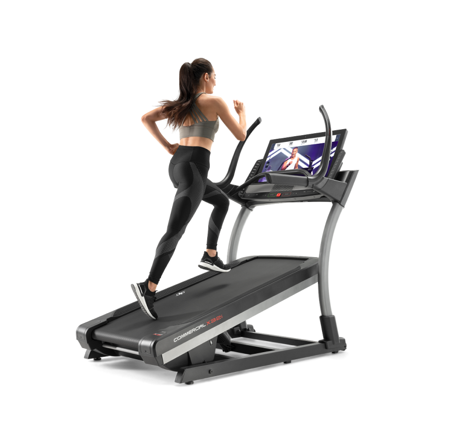Woman running on incline trainer