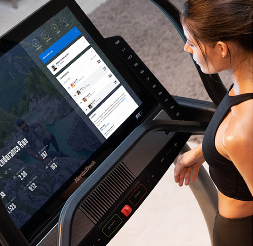 Woman does an iFIT treadmill workout
