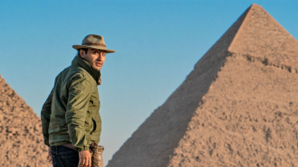 IFIT guide in front of Egyptian pyramids