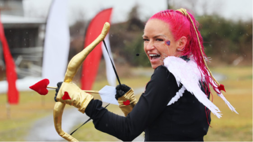 Trainer shooting an arrow at Love on the Run 5k