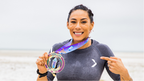 Woman at beach with medal