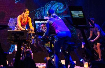 Personal trainer coaches an iFIT cycling class