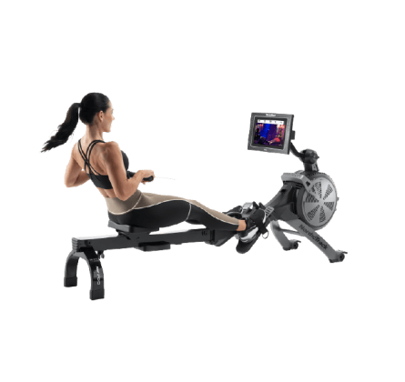 Woman does a rowing workout on an iFIT-enabled rower