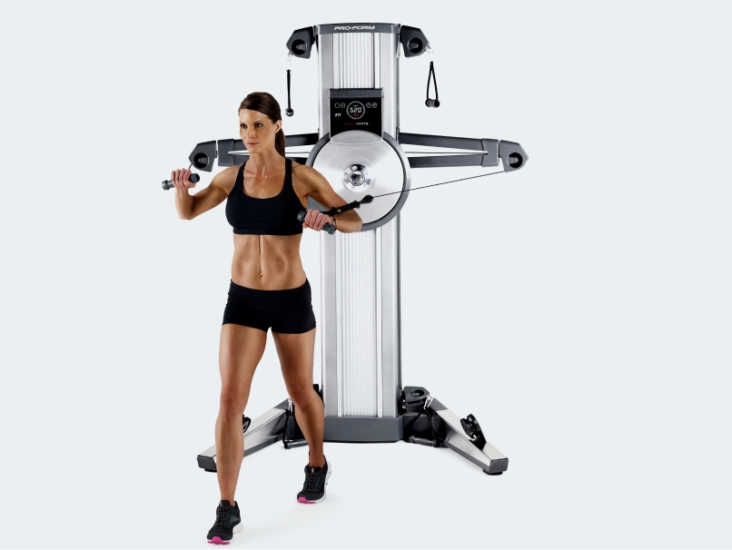 Woman uses cable exercise machine