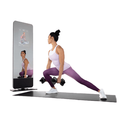 Woman does a strength workout on an iFIT-enabled fitness mirror