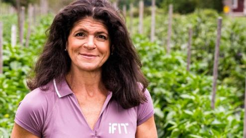 Dr. Eva Selhub stands in a garden
