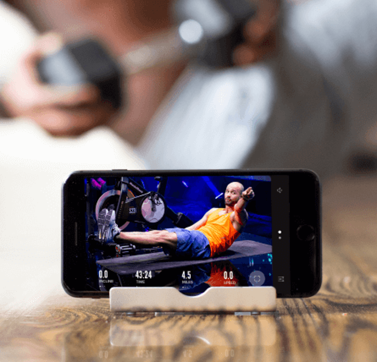 Person does an iFIT ab workout using their phone