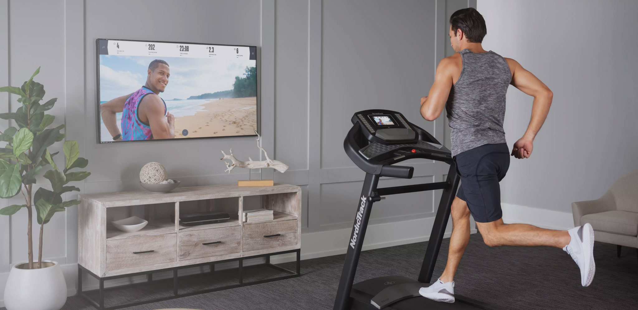 Man works out to an iFIT running class